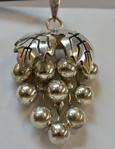 when my house started looking like a hoarding show I had to give up several collections - one of them was grape cluster jewelry. didn't wear it, just liked it. jh