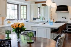 Ceramic tile behind stove, breakfast bar, and open floor plan from kitchen to dining room