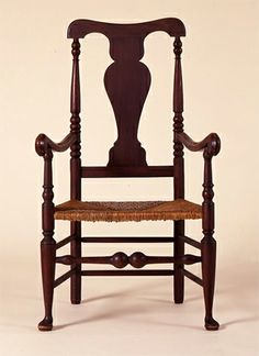 This shell-eared, carved, ball and claw foot side chair is ...