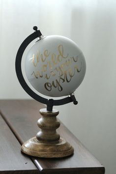 This 11 inch, wood based hand-painted globe is perfect for a nursery or on a bookshelf in your living room. The grey background and gold script
