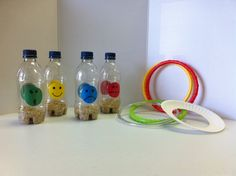 Feelings Ring Toss made from recycled soda bottles weighted with rice. Rings are dive rings or a paper plate with the center removed.