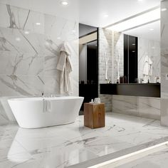 The finish bathroom floor featuring pure white Carrara marble effect