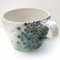 I like the delicacy of the color even though the texture is sort of brutal. Thrown and altered mug - pottery - ceramics
