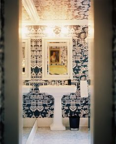 Bathroom - Blue-and-white wallpaper and a white pedestal sink in a bathroom