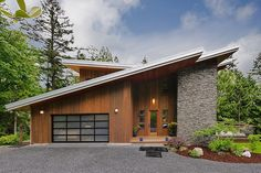 Modern Green House by Steve Moe Design. Love the combination of wood, stone and the frosted glass garage door.