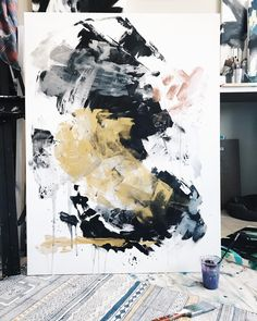 Large abstract painting, filled with golds, copper, black and white