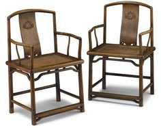 Fine pair of Chinese huanghuali southern official's back armchairs     qing dynasty     The shaped and rounded shoulder rail supports shaped and carved back splat showing twin qilong within lingzhi medallion, over shaped arms and canned soft seat, raised on joined straight legs.     H: 37 W: 22 1/2 D: 17 1/2 in.