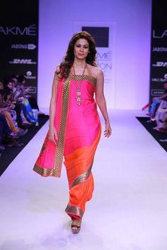 Mandira Bedi Lakme Fashion Week Summer 2014 pink and orange saree. More here: http://www.indianweddingsite.com/mandira-bedi-lakme-fashion-week-summer-resort-2014/
