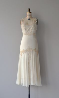 Just the most ethereal and precious antique wedding dress one can find; 1930s airy cream silk chiffon layers that catch the wind so magically right at