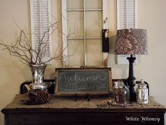 Buffet decorated for fall...love the window with shutters.
