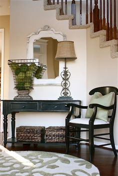 Add simple seating. Whether a rustic bench or a classic chair, a small seat in your foyer adds both convenience and visual appeal.
