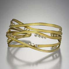 Barbara Heinrich-An 18k yellow gold cuff bracelet with 5 ribbons and 1.01 cttw scattered bezel set diamonds, measuring approximately 1.25 inches wide.