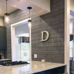 UFP-Edge 1 in. x 4 ft. Barn Wood Charcoal (Grey) Shiplap Pine Board Grey barnwood shiplap board used as an accent wall in the kitchen Home Renovation, Home Remodeling, Kitchen Remodeling, Basement Renovations, Gray Shiplap, White Shiplap Wall, White Wood Walls, Barn Wood Walls, Shiplap Diy