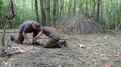 Intermediate bushcraft course students applying bow drill and shelter building