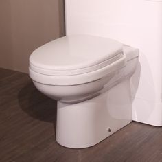 The Impressions back to wall toilet is a stylish and modern design. Wall, Space Saving Bathroom, Small Bathroom, Modern Bathroom, Toilet, Amazing Bathrooms, Bathroom Suites, Back To Wall Toilets, Bathroom Furniture