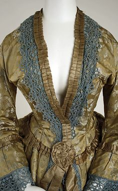 Dress, Afternoon, silk, American C1850.    Open front, structural lace trim & pleated ribbon.