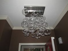 I spotted a chandelier at a local lighting shop a couple years ago that I absolutely fell in love with. Here's a picture:  I know, right?!...