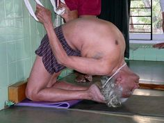 BKS Iyengar practicing Kapotasana in the ropes.