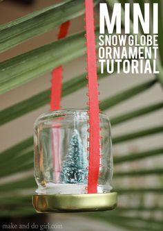 DIY Christmas Ornament Tutorial. How to upcycle empty jars into mini snow globes! Click to view the full tutorial.