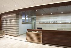 """Visually paramount to the design is the bold """"bumble bee"""" stripe carried throughout the millwork and reinvented more subtly int eh flooring and feature ceiling in the boardroom."""