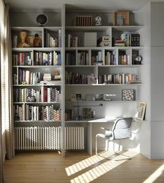 I like this home office very much. The radiator didnt prevent the owners from building around it. Its a clever use of the space, so bright and cozy