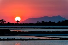 Saline di Mozia - This is a view of a sunset behind Favignana Island in Sicily, taken from Saline di Mozia..