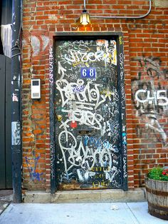 Here we see graffiti written all over this door. This vandalism represents the profanity Holden sees written on the walls of Phoebe's schools. He tries to erase the cuss words away because he wants to protect the innocence of children.