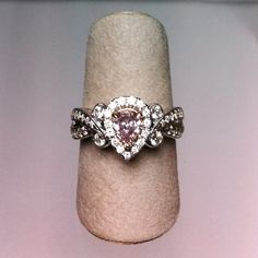 Natural fancy pink pear-shape diamond (.45ct) engagement ring with white diamonds in surrounding halo and along a partial split-shank, in 18kw. At DVVS Fine Jewelry