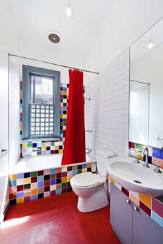 Funky coloured tile bathroom with red floor - North Melbourne, Australia