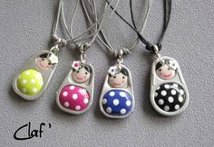 soda can tabs with polymer clay added to make these little doll pendants. they have kitties, too...clever