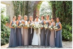 Bride and bridesmaids in the courtyard at Summerour Studio in Atlanta. Wedding dress by Reem Acra, bridesmaid dresses by Jenny Yoo, bouquets by Victory Blooms with ribbon by Silk & Willow. Image by Rustic White Photography.