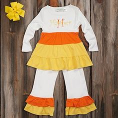 Please oh please can I dress her up like adorable human candy corn- just one time?