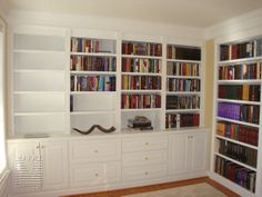 Built-in cabinetry with file drawers, fluted stiles and matching inset bookcase  units