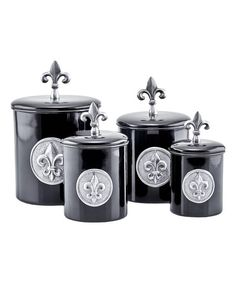 Keep dry ingredients and snacks fresh with this set of stainless steel canisters detailed with eye-catching fleur-de-lis.