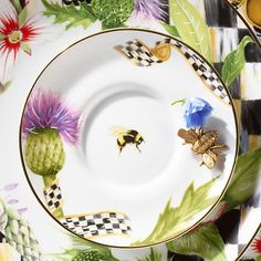 Thistle & Bee Saucer: There's been quite a buzz about our take on formal china. Handcrafted in Portugal, the Thistle & Bee Saucer is trimmed in gold lustre and features a striking decaled suite of Scottish highland thistles and Courtly Check ribbon, with a single bumblebee in flight at the center of it all. Fine enough for the fanciest of occasions, but so sweet you'll want to use it for an everyday treat.