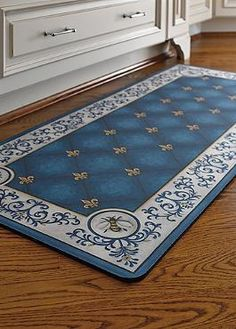 Comfortably prepare for your next dinner party atop the cushioned French Country Kitchen Mat that also serves as a classic decor accessory for your kitchen.