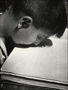 A blinded boy reading braille with his lips due to the loss of his arms and legs. David Seymour. 1948. Corcoran Gallery of Art, Washington, D.C.