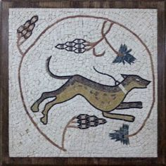 Greyhound, by Firas and Wael. New Media: stones, cement, wood frame, handmade mosaic