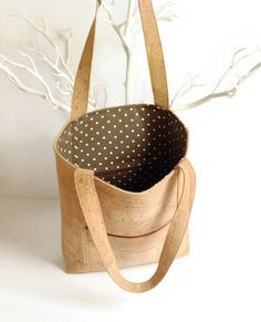 This eco friendly bag made from natural cork it will be your favourite everyday accessory because it is light and roomy as well as sturdy and durable! If youre looking for something attractive and stylish and you care about the environment, then this is it! This bag was made using the