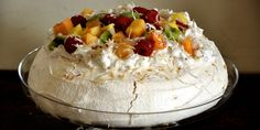 Ginger Pavlova with Coconut Whipped Cream and Tropical Fruit