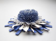"""As part of a new body of work on view at the COLLECT Art Fair which opens today in London, artist Zemer Peled (previously) created a new series of """"blooming"""" sculptures from assorted ceramic shards. The new pieces include her continued use of blue cobalt found in traditional Japanese pot"""