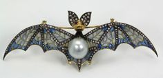❤ -Plique a jour bat brooch.  The bat supports a huge south sea pearl with high luster two small rubies for the eyes, a black enamel neck and approximately 150 diamonds in the wings and body and 18 diamonds on his ears.  Also fitted with loops to hang as a pendant.