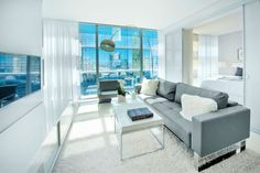 Contemporary glass sliding doors between living area and bedroom (select residences)