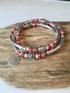 This Stunning Bohemian Style Bracelet/Necklace will be noticed and adored! Its made to wrap around your wrist three times and connects with a lobster clasp. It has an extension chain to adjust to a tight or loose fit. You can choose a charm of your choice! Please see the last