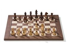 The plug & play DGT electronic chess board brings you the best of two worlds. The classical game of chess finaly merged with century computer and internet technology. The beautiful classic wooden DGT e-Board Computer Chess, Pi Computer, Chess Store, Luxury Chess Sets, Bluetooth, Online Match, Logic Games, Usb, Chess Pieces