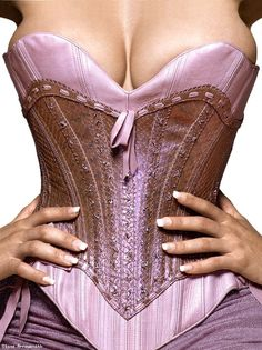 This corset with tan leather skirt and boots would be great for Ren Fest Pirate Weekend!