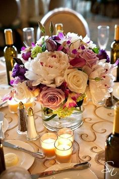 47 Bright Floral Centerpieces For Spring Weddings (Love the scroll work on tablecloth)