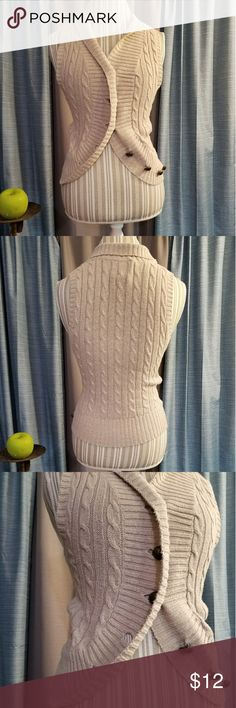 🌻🌺🌻CUTE KNITTED BUTTONED VEST!! SIZE:medium   BRAND:Love Lola   CONDITION:good except one button has a scuff on it as seen in last photo. Picture shows a mark in the front near collar, this is a shadow and not there in person.    COLOR:tan   🌟POSH AMBASSADOR, BUY WITH CONFIDENCE!   🌟CHECK OUT MY OTHER ITEMS TO BUNDLE AND SAVE ON SHIPPING!   🌟OFFERS WELCOME!   🌟FAST SHIPPING! love lola Jackets & Coats Vests