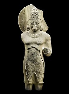 'Surya, the Sun God, second half of 7th to early 8th century. Central Thailand. Lent by National Museum, Bangkok. | This male deity, wearing a faceted crown framed by a circular nimbus, may be identified as Surya, the solar god who holds two lotus buds or blossoms in his raised hands to evoke the life-affirming power of the sun. #LostKingdoms