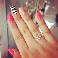 Neon pink nails with black & white strips & silver glitter